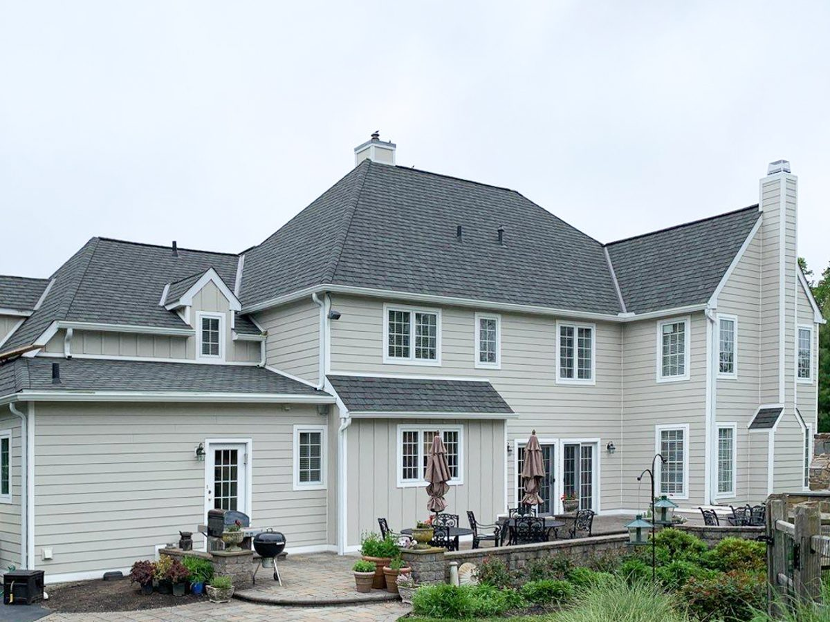 smucker exteriors west chester roofing installs and repairs asphalt shingle house